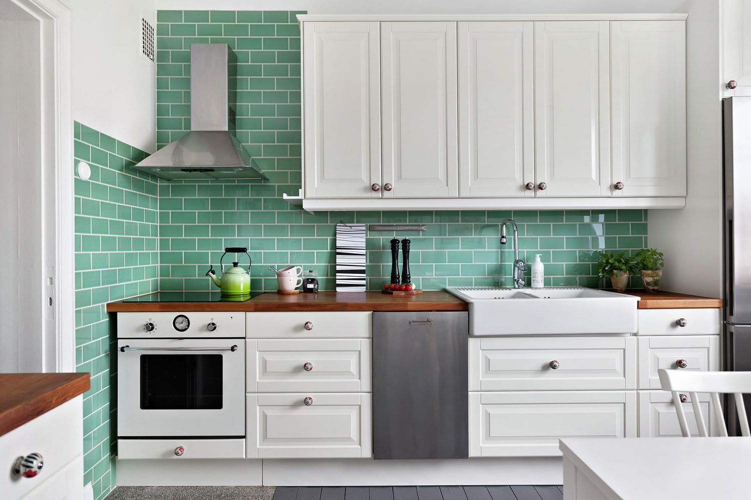 White IKEA Kitchen with Green Tiles