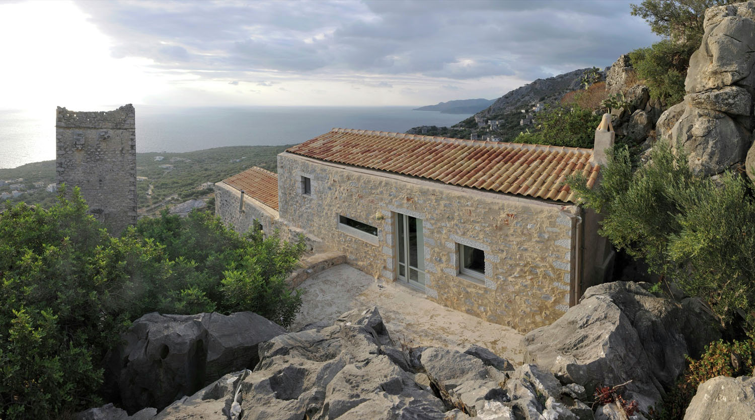 Historical stone building in greece transformed into for Building a stone house