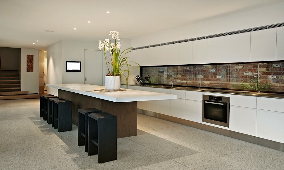 Sleek Modernist Kitchen with Brick Wall