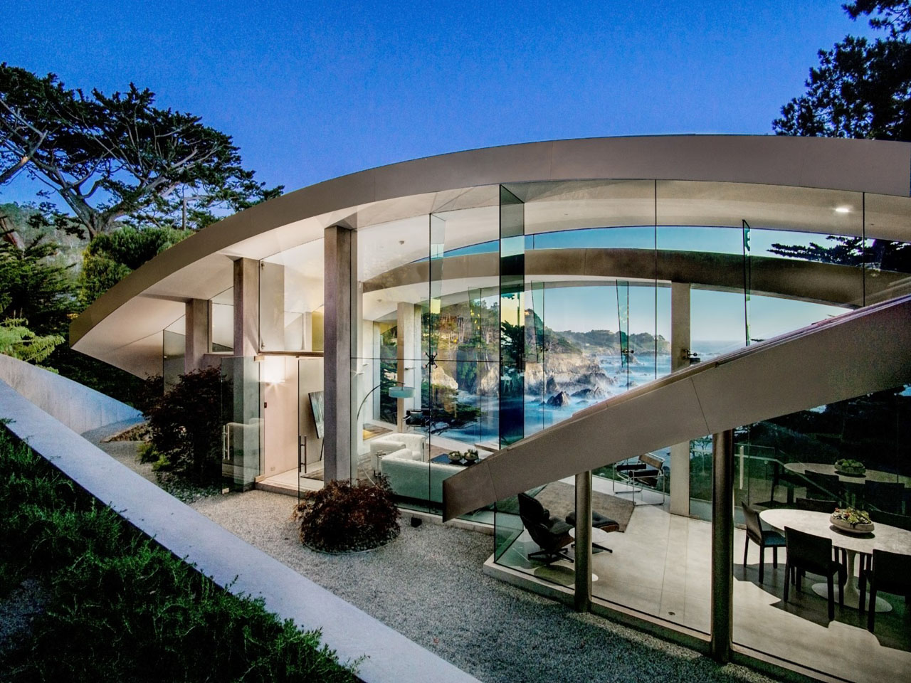 This butterfly shaped concrete glass steel house is a for Glass houses for sale in california