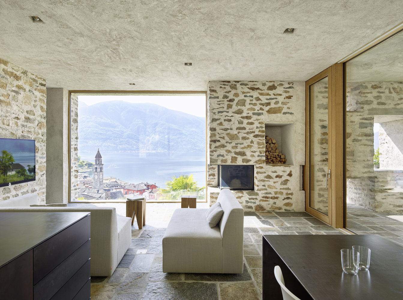 Modern stone house with terraced garden overlooking lake for Stone house interior
