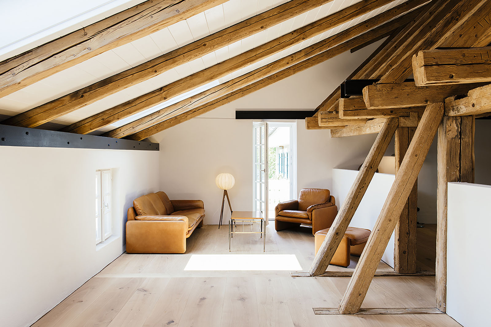 Renovated Attic Space with Exposed Wood Beams