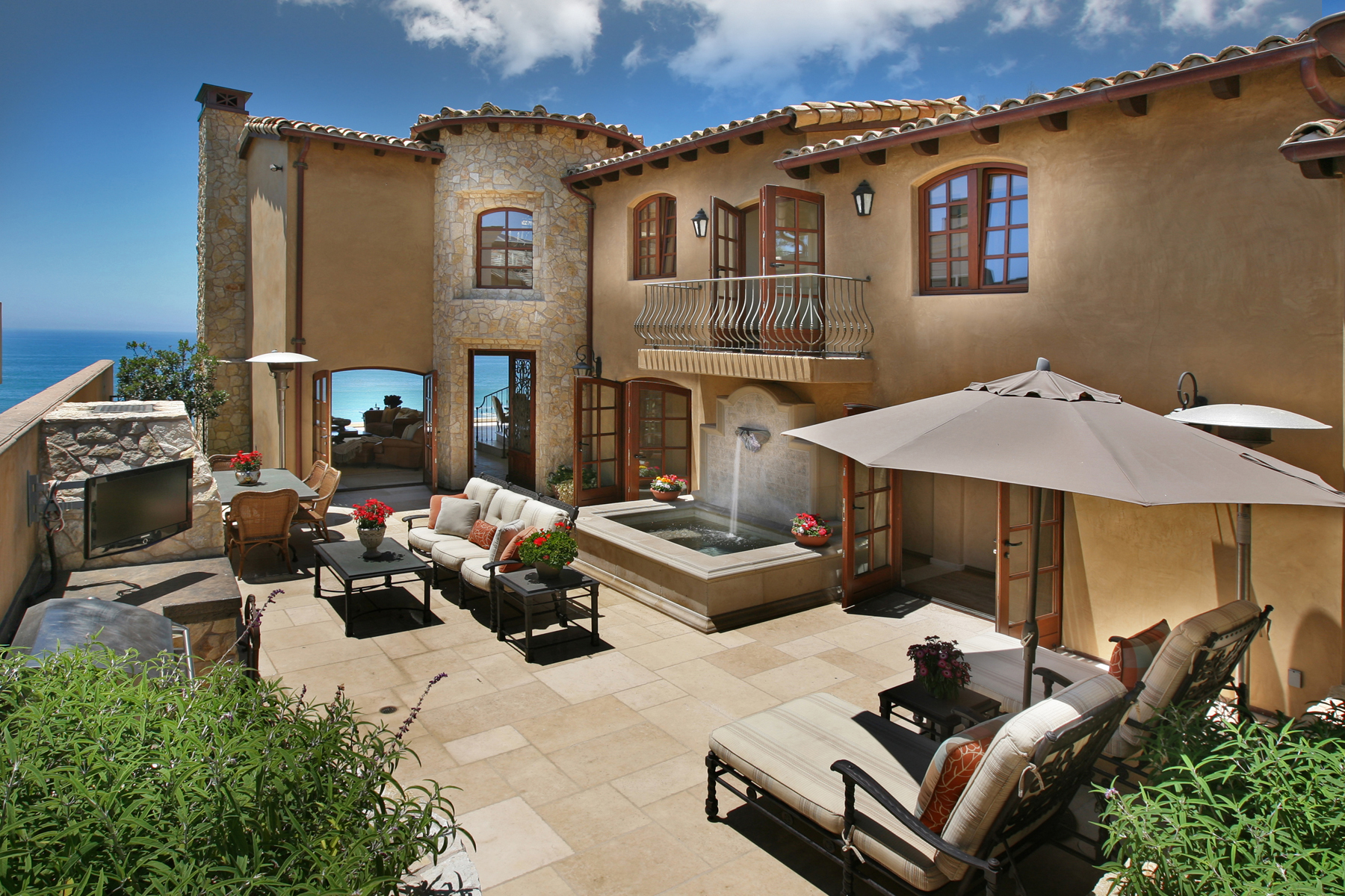 Luxury beach homes exterior - Mediterranean Style Courtyard