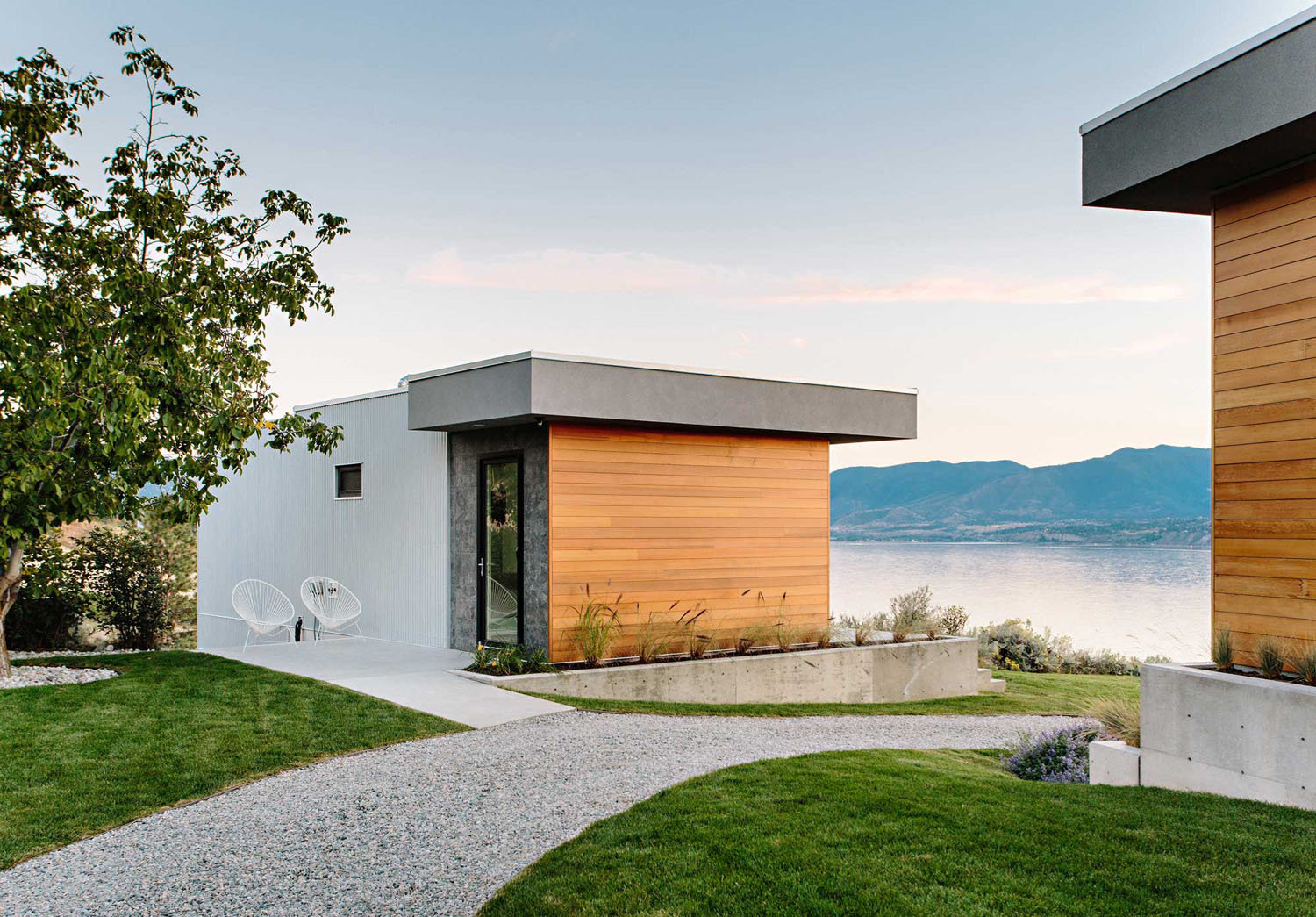 Living on the edge a glass and concrete cantilevered for Small house design kelowna