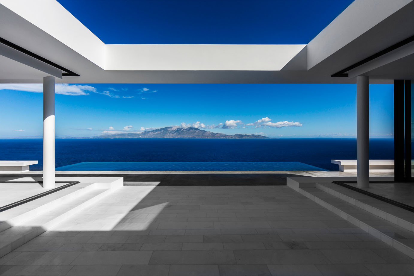 home architecture and design minimalist greek villa with dramatic ocean and island view