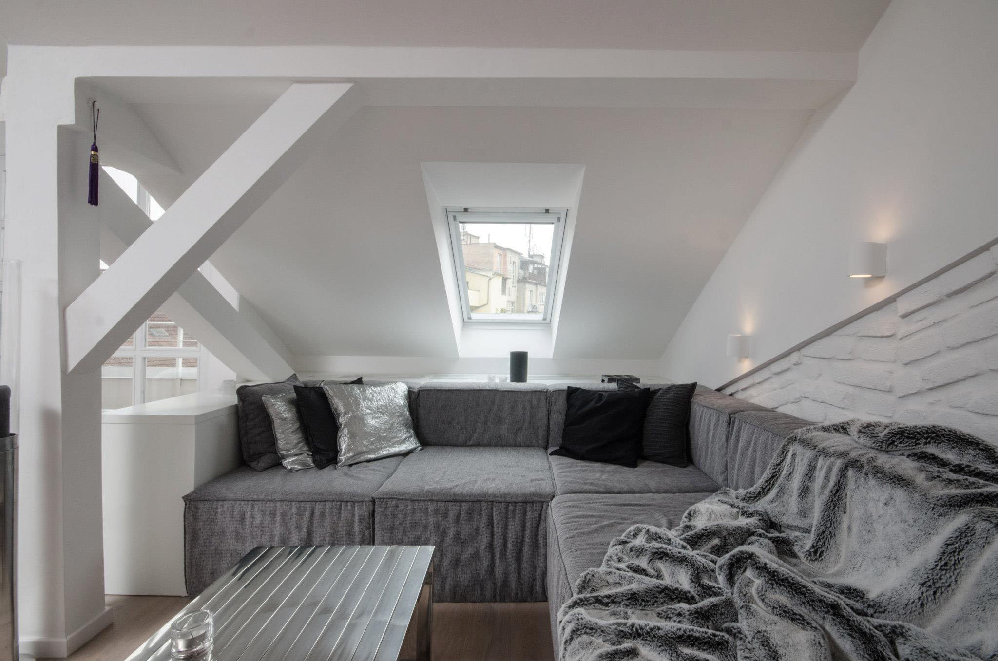 modern attic loft with grey palette in prague. Black Bedroom Furniture Sets. Home Design Ideas
