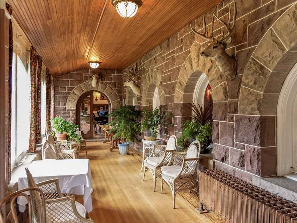 english tudor-style american castle in the rocky mountains