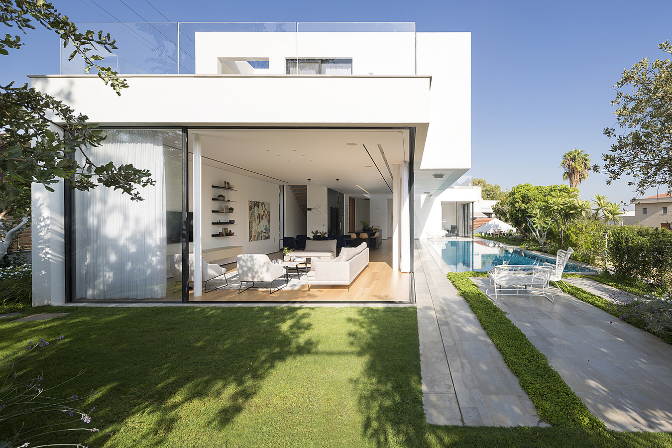 Modern family home in israel seamlessly connects with the for L shaped house pictures
