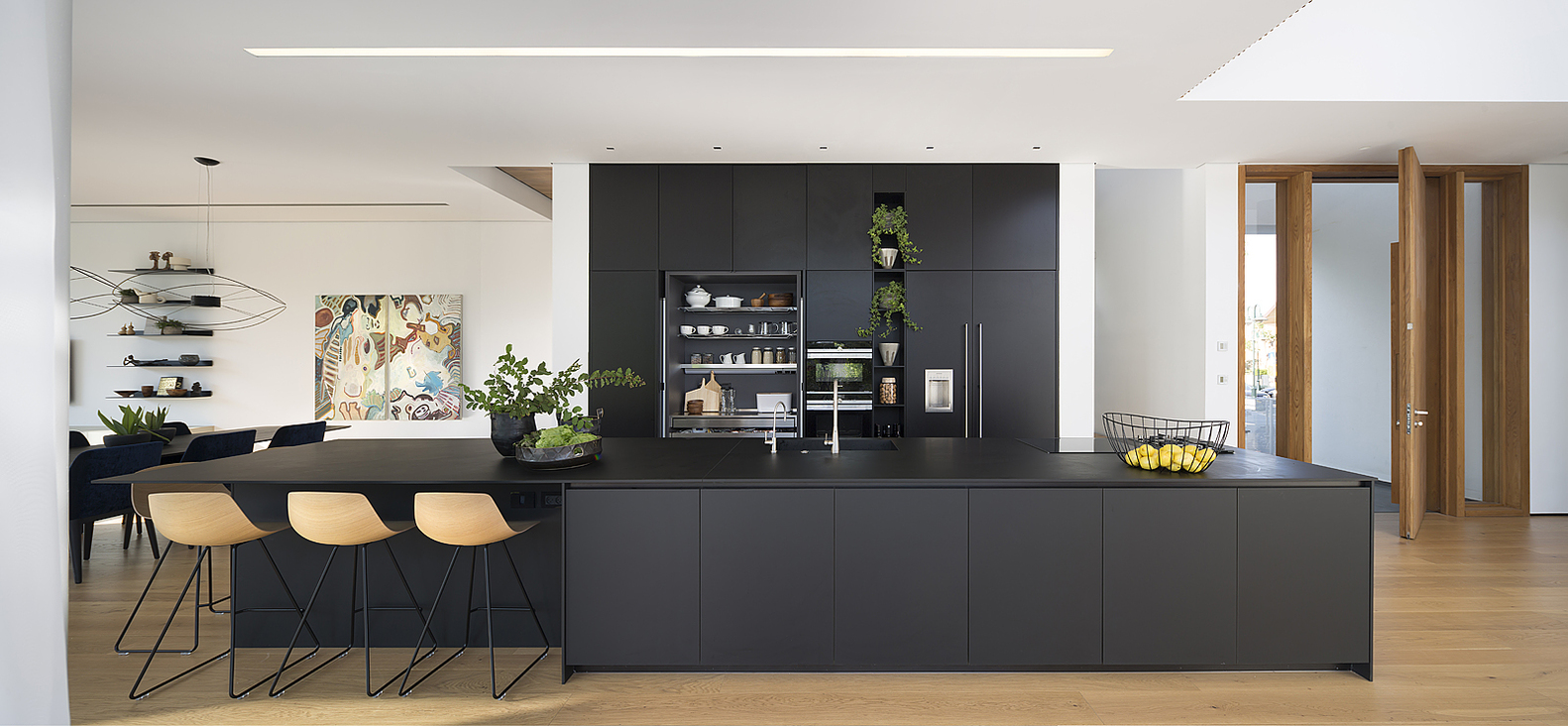 Modern Kitchen with Black Cabinets and Black Countertop