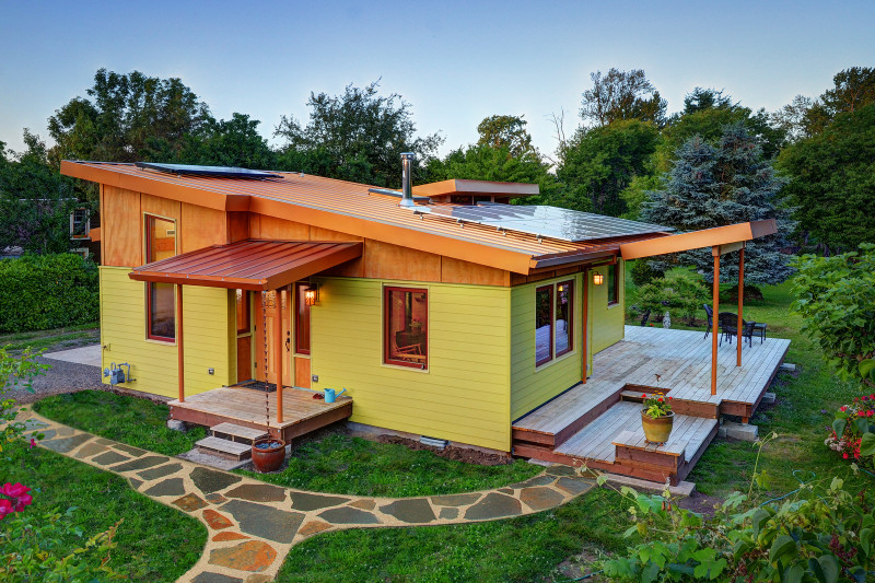 sustainable home combines cozy spaces with an expansive character