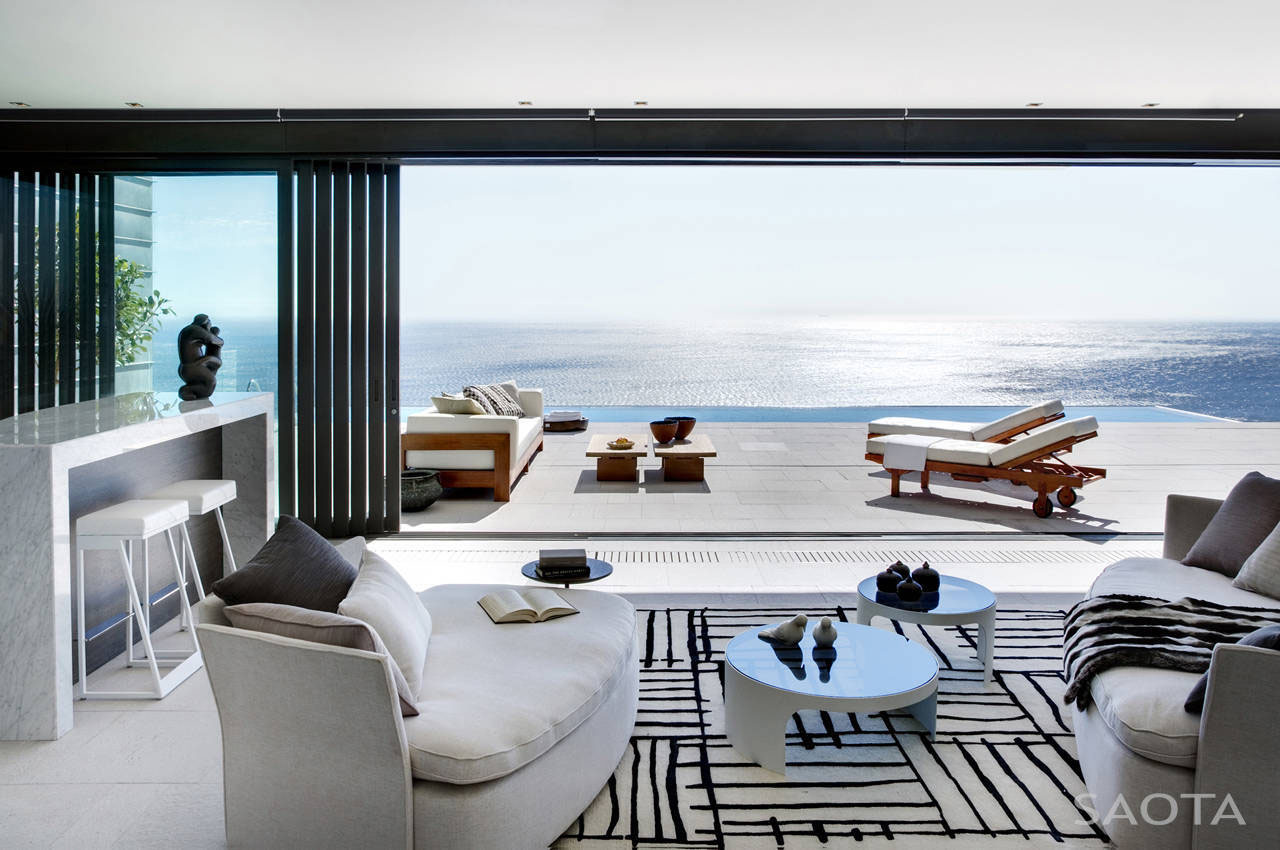 Modern private residence with dramatic living room for Beach house view