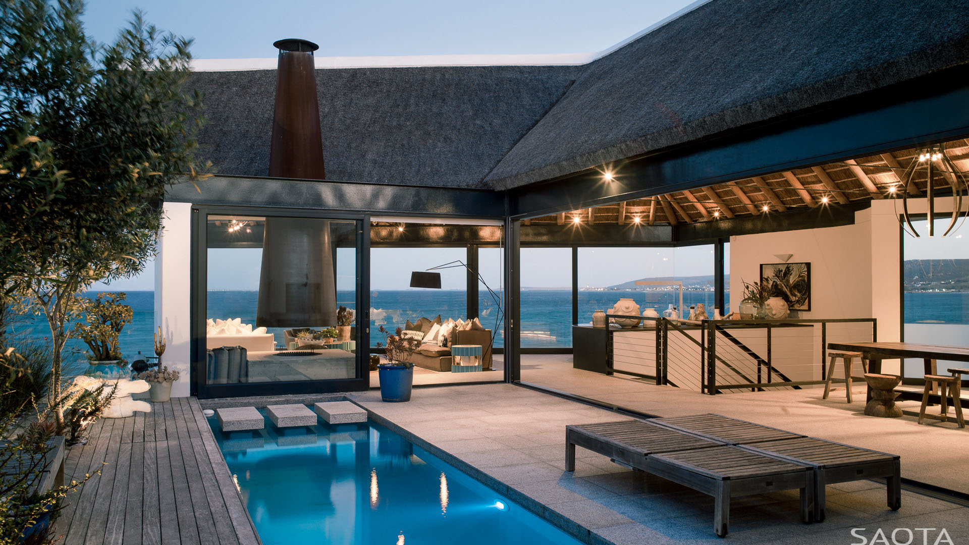 Ocean view contemporary luxury home with thatched roof for Beach house design cape town