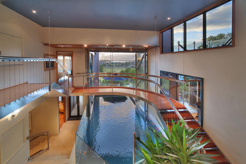 Stylish modern sea view mansion in auckland with indoor for Pool design auckland