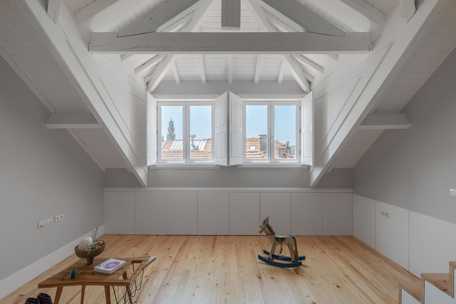 Modern Refurbished Attic Apartment with White Wood Beams