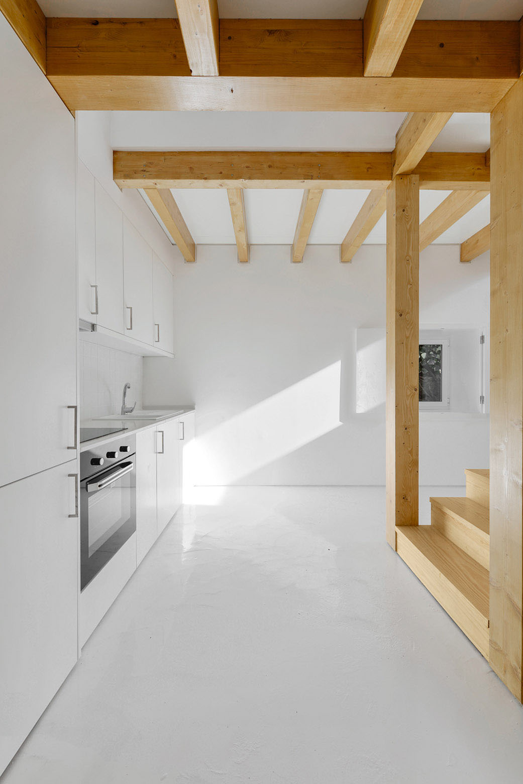 White Minimalist Kitchen with Wood Beams