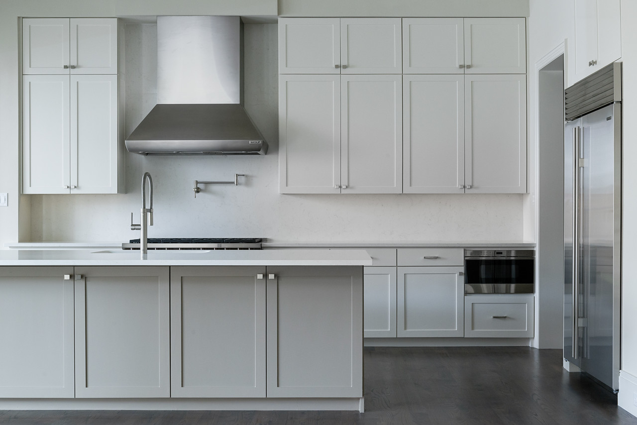 Clean Lined Contemporary White Kitchen with Ceasarstone Countertops