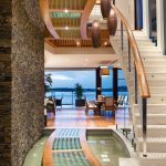 Contemporary Waterfront Island Home with a Tropical Resort-Style Design