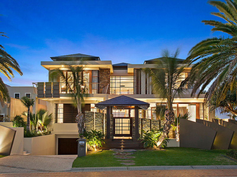 Contemporary waterfront island home with a tropical resort for Design hotel queensland