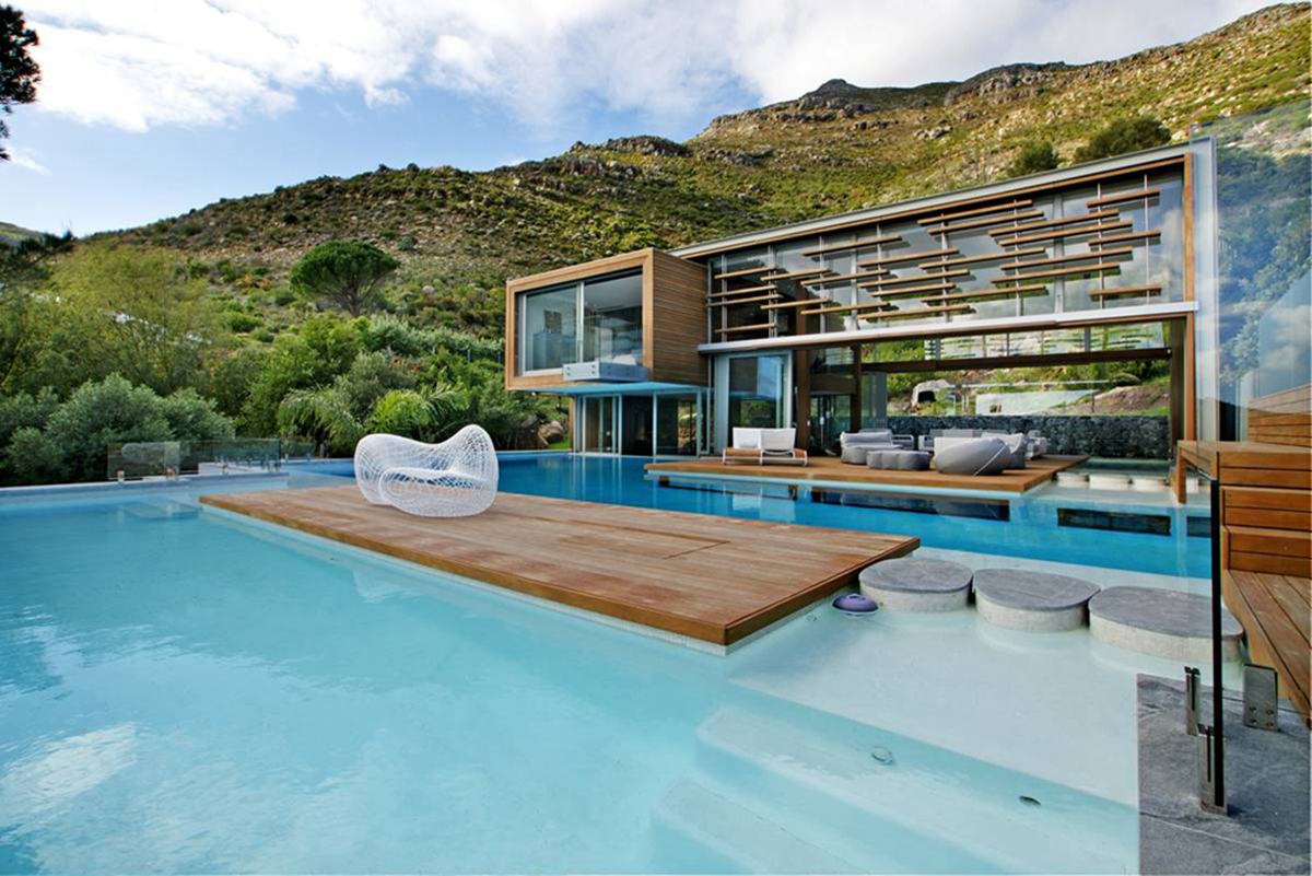 Residential spa house for a mountainside home for Home plans with pools