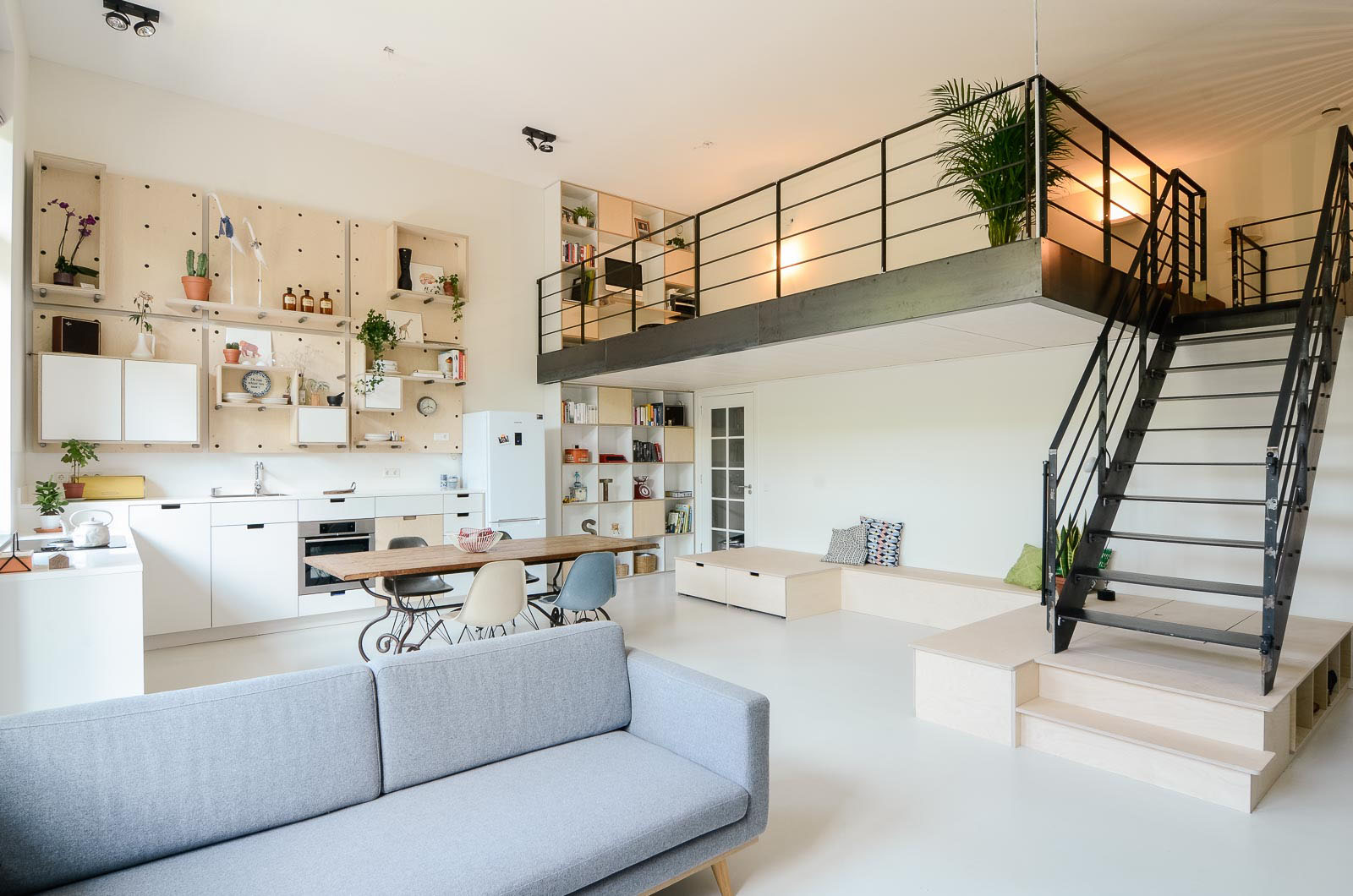 Old school building converted into modern family loft for Living in a model apartment