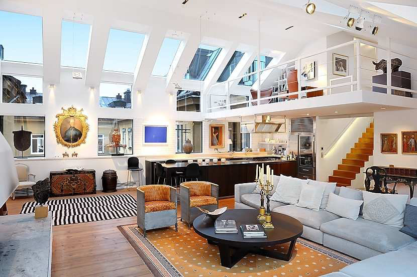 the loft features modern interior design with a very open floor plan