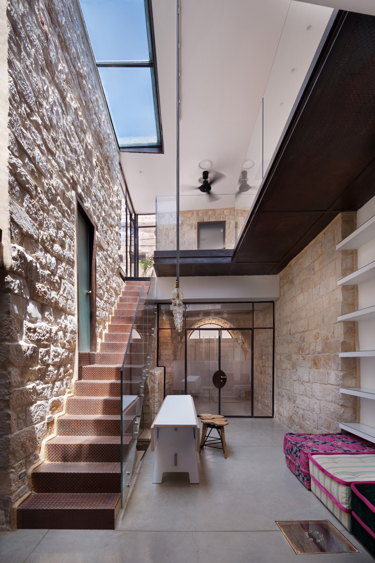 Stone house in israel built in the shape of the hebrew for Stone interior design