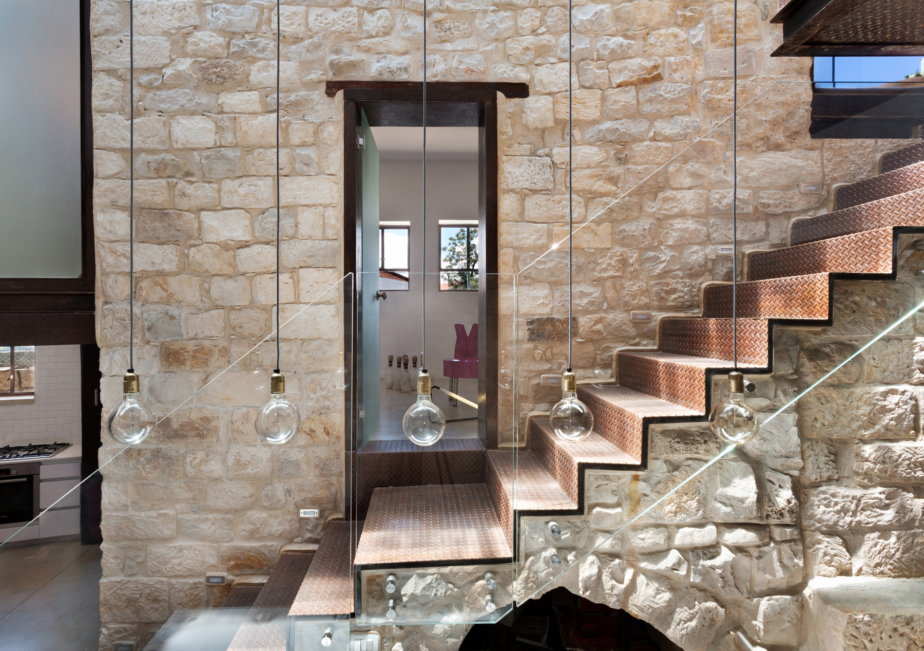 Stone house in israel built in the shape of the hebrew for Modern stone houses architecture