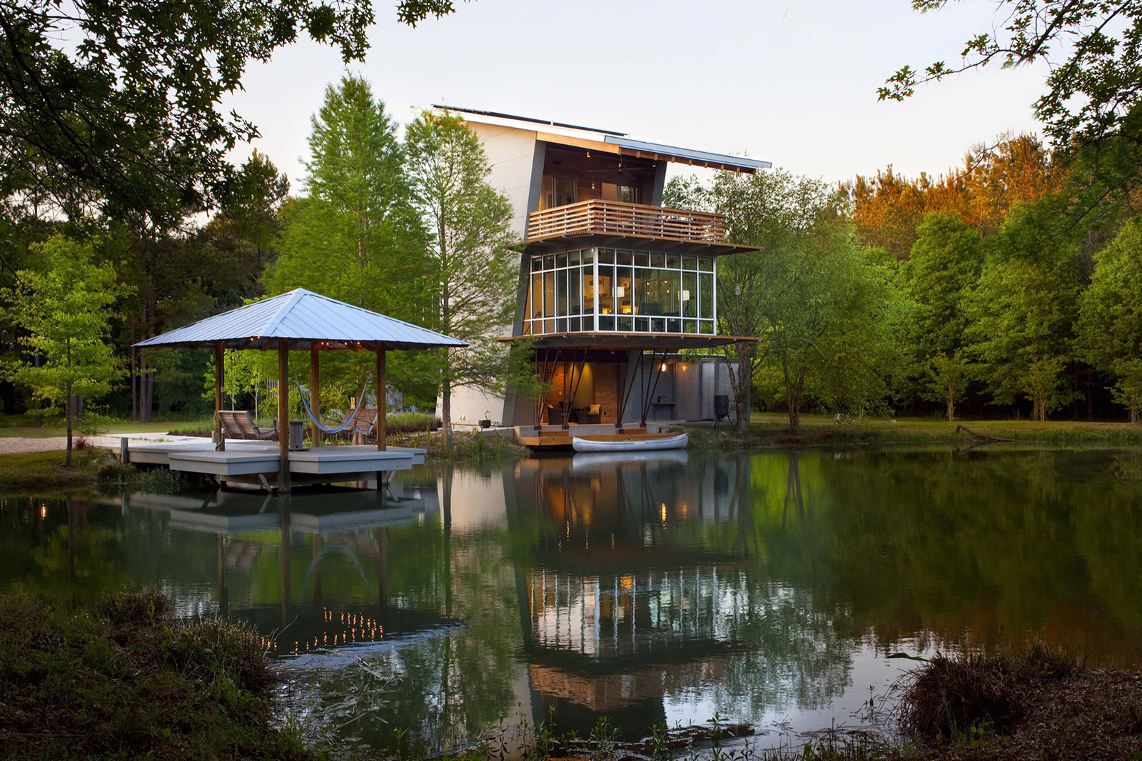 tranquil modern retreat on the edge of a pond