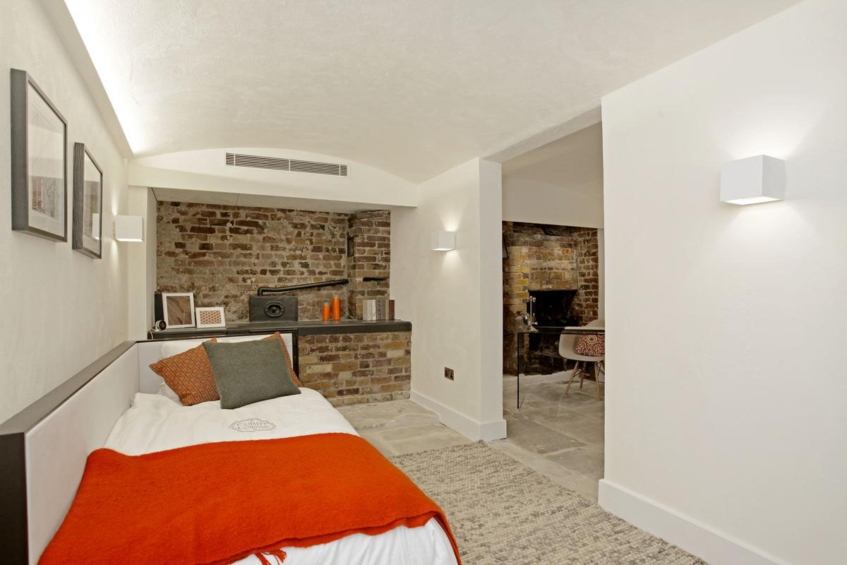 Modern Bedroom with Brick Wall