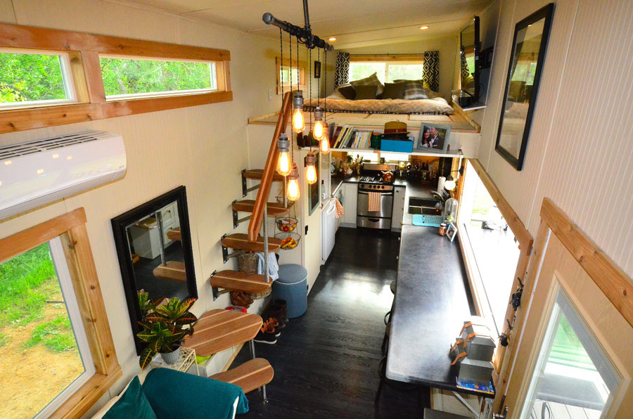 Tiny house on wheels with indoor outdoor entertaining for Small house design inside and outside