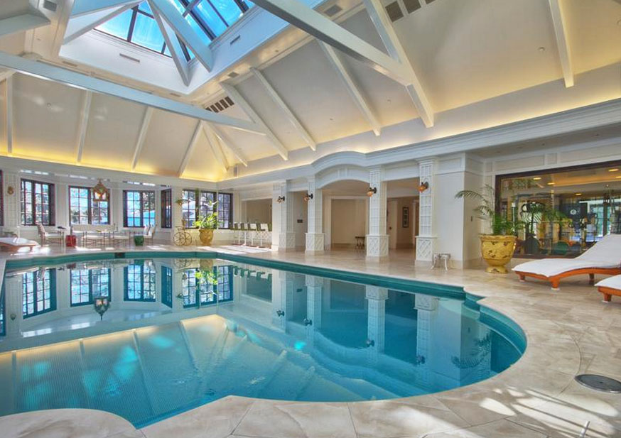 elegant private indoor glass mosaic swimming pool with atrium