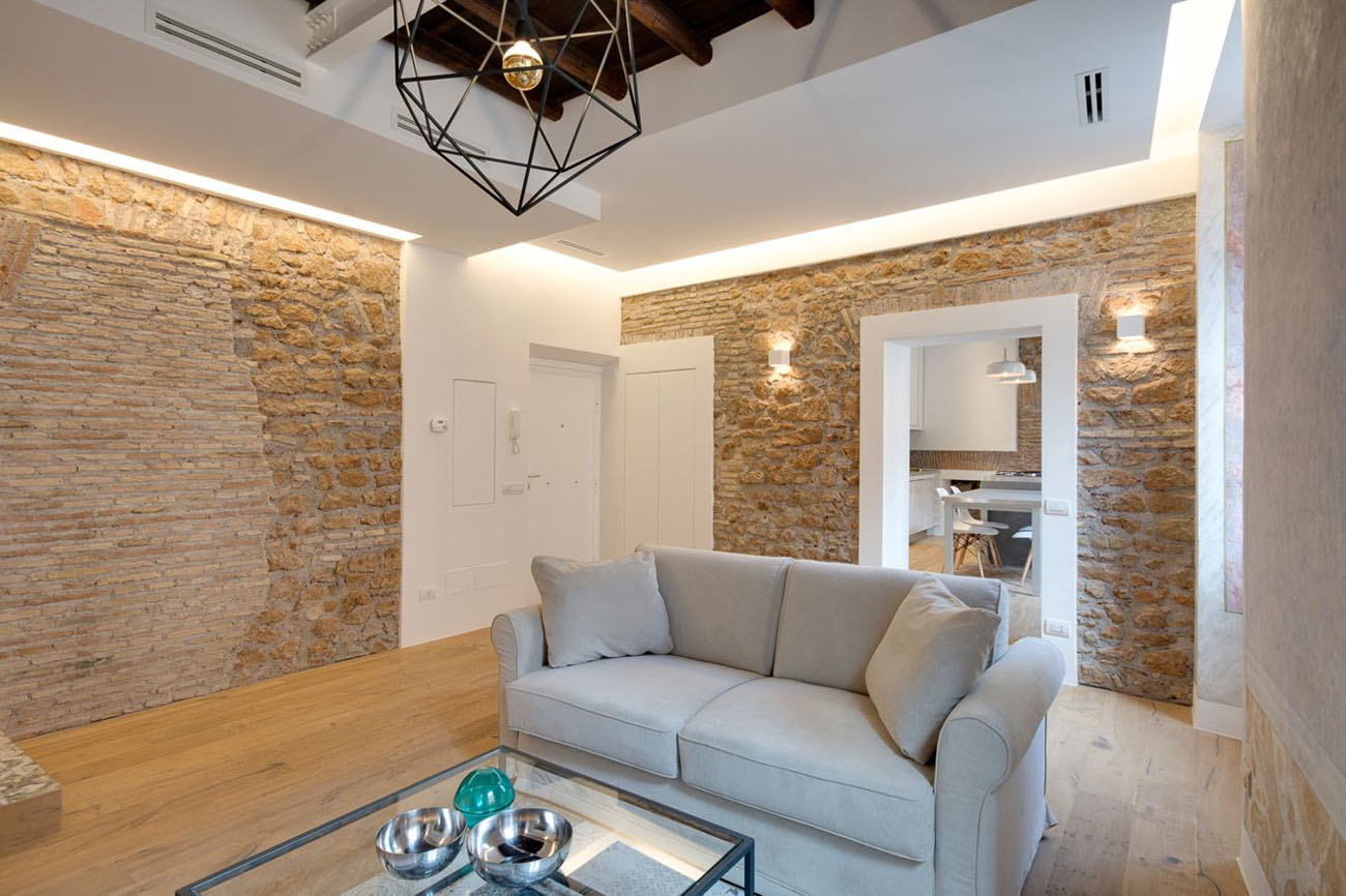 Modern Rome Apartment Living Room with Stone Walls