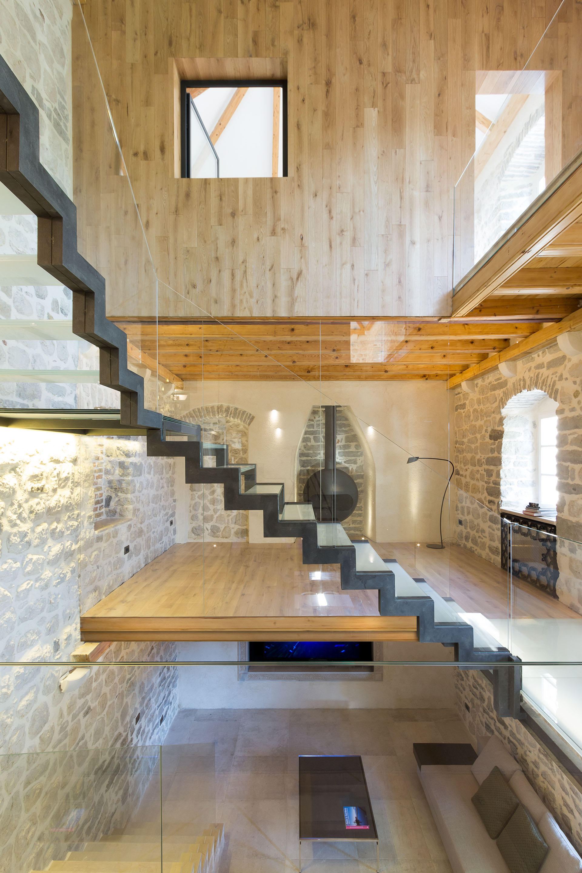 Modern renovation of a 19th century old stone house in for Modern stone houses architecture