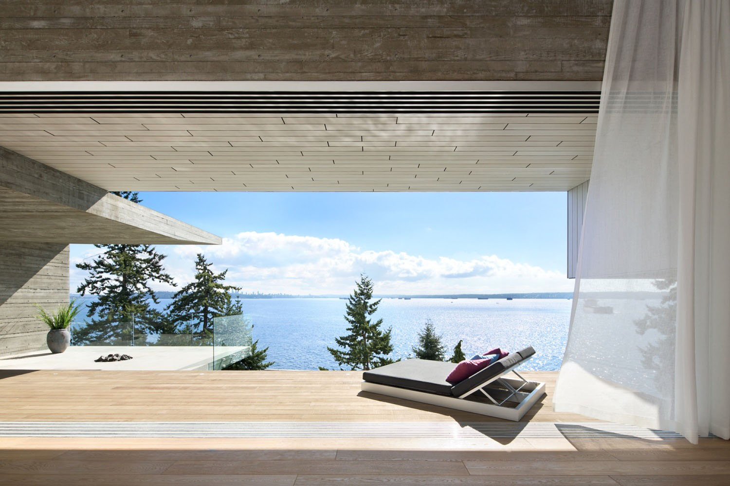 Minimalist concrete house with intimate interior spaces for Pool design vancouver