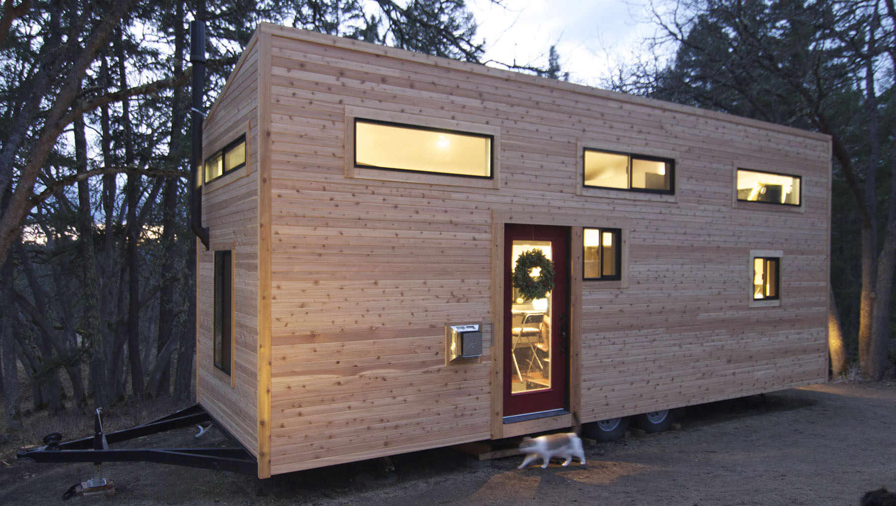 Elegant minimalist tiny house on wheels with staircase for Tiny house minimalist
