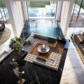 Open Concept Sunken Living Room Surrounded by Indoor Pool and Black Marble