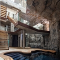Modern Cave Villa Built into a Massive Rock with Underground Grotto