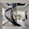 Spiral Staircase and Glass Elevator Breaking Through Transparent Floors