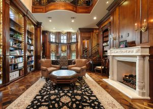 Two-story study features mahogany walls and elegant decor