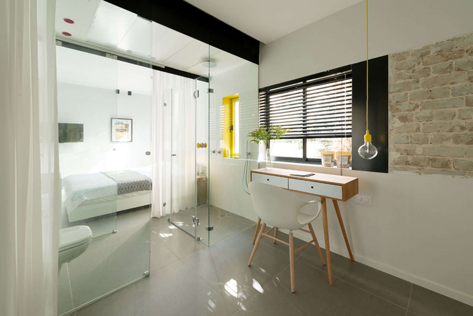 600 Square Foot Apartment Uses Glass Walls To Create Two Bedrooms