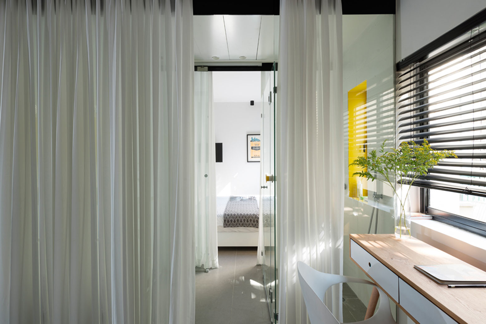 600 Square Foot Apartment Uses Glass Walls To Create Two