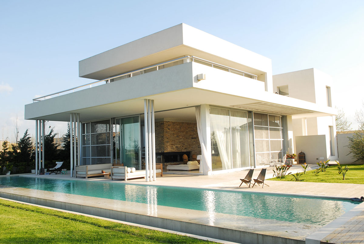 Modern stone wall house with water elements