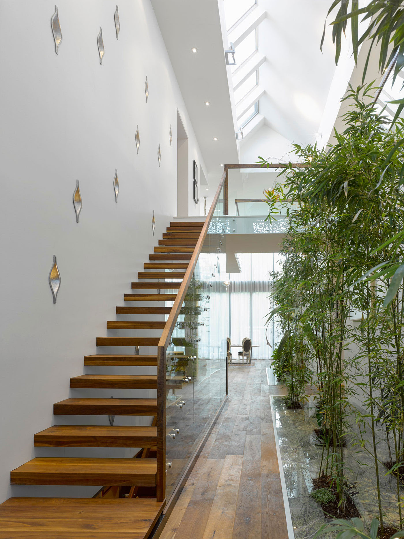 Atrium with Glass Staircase and Bamboo Garden