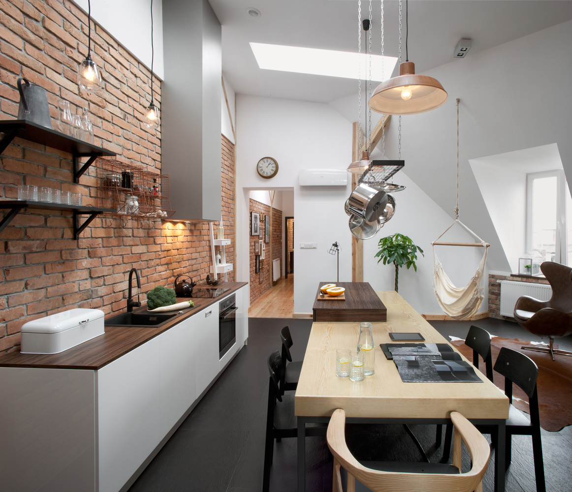 Attic-Loft-Apartment-with-Brick-Walls-and-Exposed-Wood-Poland_1