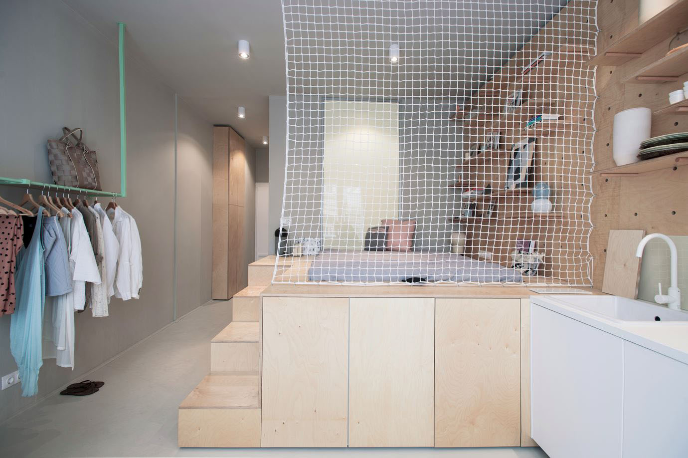 Tiny Studio Apartment With Multifunctional Sleeping And Storage Unit
