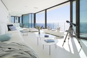 Modern Living Room with Large Glass Windows and Ocean View