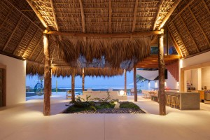 Tropical Beachfront Home with Thatched Roof