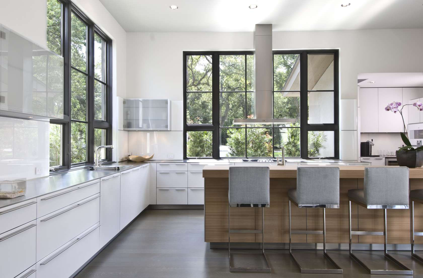 Bright Modern White Kitchen with Stainless Steel Appliances
