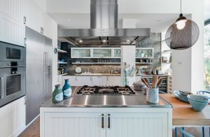 Contemporary White Kitchen with Stainless Steel Countertops