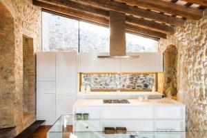 Modern Kitchen with Stone Walls